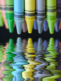 Colorful crayons. With beautiful reflection on black background Royalty Free Stock Image