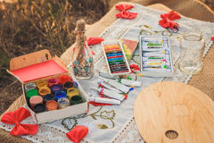 Colorful crayons, acrylic paints and bottle with wishes Stock Photo
