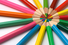 Colorful crayons arranged in circle Royalty Free Stock Photos
