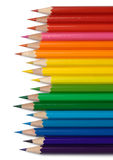 Colorful crayons arranged in line by colors Royalty Free Stock Photography