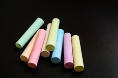 Colorful crayons on a black background. Close-up top view. Cool Stock Image