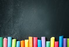 Colorful crayons on the blackboard, drawing. Back to school background. Selective focus. Background with copy space stock photo