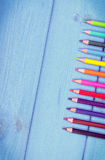 Colorful crayons on boards, school accessories, copy space for text Royalty Free Stock Photo