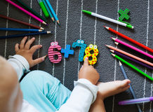 Colorful crayons and figure with small toddler hands. Preschool. And kindergarten background. Back to school concept Stock Images