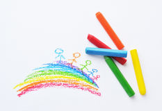 Colorful crayons and kid's drawing Stock Photography