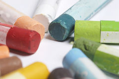 Colorful crayons pastels lie in a circle. Stock Photography
