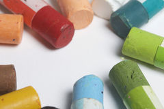 Colorful crayons pastels lie in a circle. Stock Photo