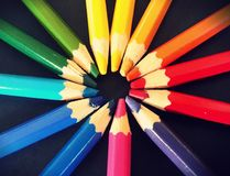 Rainbow crayons round stock photos