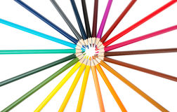 Colorful crayons in round shape Royalty Free Stock Images