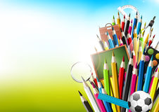 Colorful crayons with school supplies Royalty Free Stock Images