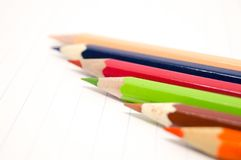 Colorful of crayons on white paper. A sharpener hone  crayons to sharp for drawing Stock Photo