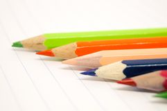 Colorful of crayons on white paper. A sharpener hone  crayons to sharp for drawing Stock Photography