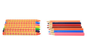 Colorful crayons and wooden pencils isolated on wh Royalty Free Stock Photos