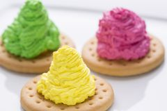 Colorful creamy cakes. On white Royalty Free Stock Photography