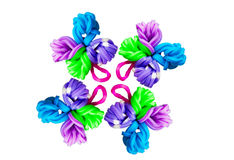 Colorful creations with rubber bands on rainbow loom. A Colorful creations with rubber bands on rainbow loom Royalty Free Stock Image