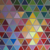 Colorful creative geometrical abstract shaped interior wall pain. T texture background. Yellow, blue, pink, purple, violet, orange, red, green, grey, brown Royalty Free Stock Images