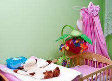 Colorful crib. Of a baby girl Royalty Free Stock Photos