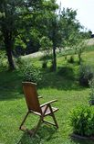 Garden chair for recreation in calm surroundings Stock Photography