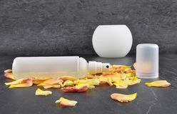 Natural cosmetics and rose petals on shale stock photos