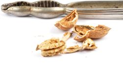 Walnuts cracked with nutcracker on white Stock Photography
