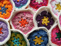 Colorful crochet. A collection of colorful crocheted African Flowers Royalty Free Stock Images