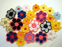Colorful crochet flowers Stock Photos
