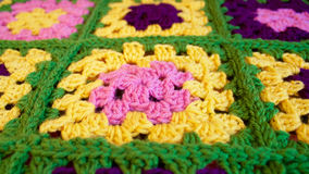 Colorful crochet granny square blanket. Handmade crochet square blanket full of vibrant colors Stock Images