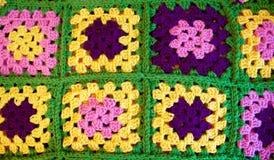 Colorful crochet granny square blanket. Handmade crochet square blanket full of vibrant colors royalty free stock photo