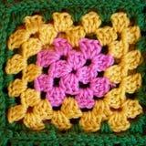 Colorful crochet granny square pattern. Handmade crochet square full of vibrant colors Stock Photo