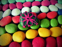 Colorful crochet and painted stones pattern Stock Image