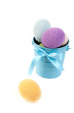 Colorful crocheted eggs in a blue bucket Royalty Free Stock Photography