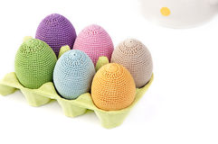Colorful crocheted eggs in a box Stock Images