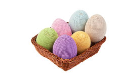 Colorful crocheted eggs in a wicker basket Royalty Free Stock Image
