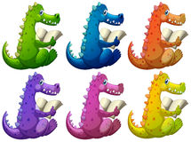 Colorful crocodiles reading Stock Photography