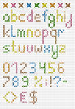Colorful cross stitch lowercase english alphabet with numbers an Stock Photo