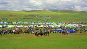 Colorful crowd at Naadam festival area stock footage