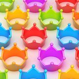 Colorful crowns over the white surface Stock Images