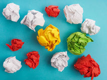 Colorful crumpled paper on blue Stock Photo