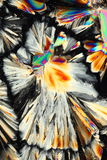 Colorful crystals. Shards of colorful crystallized citric acid viewed under polarized light Stock Photography