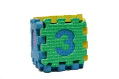 Colorful cube puzzle of odd numbers - three Stock Photos