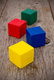 Colorful cubes on the old floor Royalty Free Stock Photos