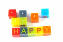Colorful cubic candles with letters Royalty Free Stock Image