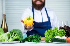 Colorful culinary. Vegetarian diet concept. Chef cooking sweet pepper. Man wear apron cooking in kitchen. Man cooking. Healthy recipe pepper vegetable. Cooking royalty free stock image