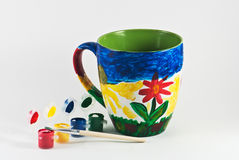 Colorful cup. With watercolors and brush Stock Image