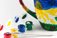 Colorful cup. Detail of the part of cup and watercolors and brush Stock Image