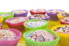 Colorful cup cakes Stock Images