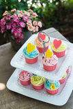 Colorful of cup cakes on shelf dish Stock Image