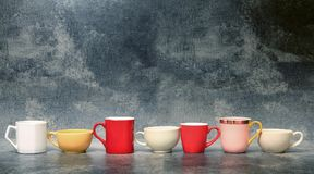 Colorful cup of coffee with concrete background. Colorful cup of coffee with old concrete background Royalty Free Stock Photos