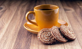 Colorful cup of coffee and cookies. Stock Photography