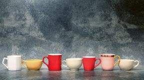 Colorful cup of coffee. With old concrete background Royalty Free Stock Images